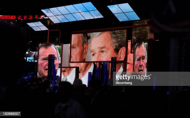 Delegates watch a video about former U.S. President George W. Bush at the Republican National Convention in Tampa, Florida, U.S., on Wednesday, Aug....