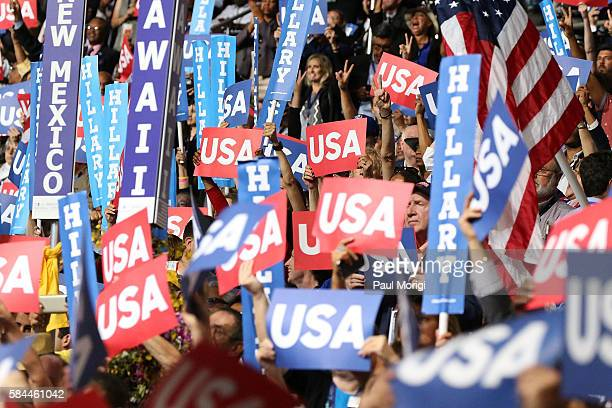 Delegates wave signs and flags on the fourth day of the Democratic National Convention at the Wells Fargo Center on July 28 2016 in Philadelphia...