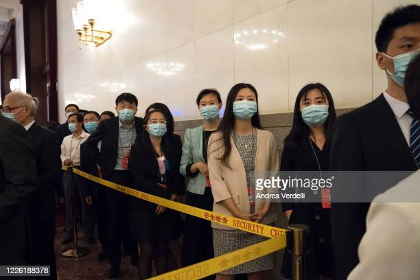Delegates wearing face masks gather into the Great Hall of the People before the beginning of the Chinese People's Political and Consulting...