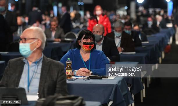 Delegates with face masks attend the Party Congress of farright AfD party at the Wunderland Kalkar, western Germany, on November 28, 2020.