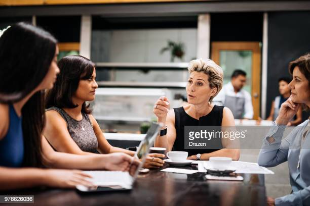 delegating responsibilities among colleagues - delegating stock photos and pictures