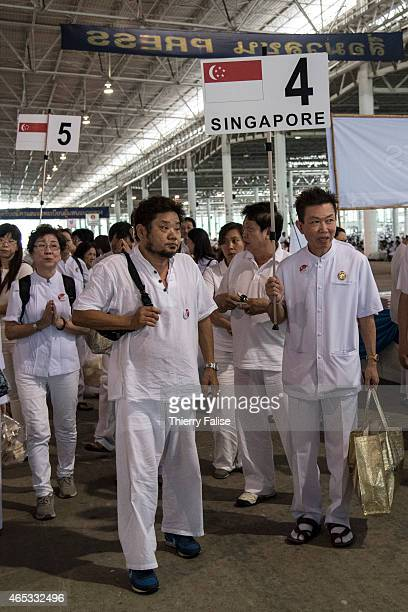 Delegation from a Dhammakaya temple's Singapore branch arrive for Magha Puja day, one of the main Buddhist celebrations. Dhammakaya temple, one of...
