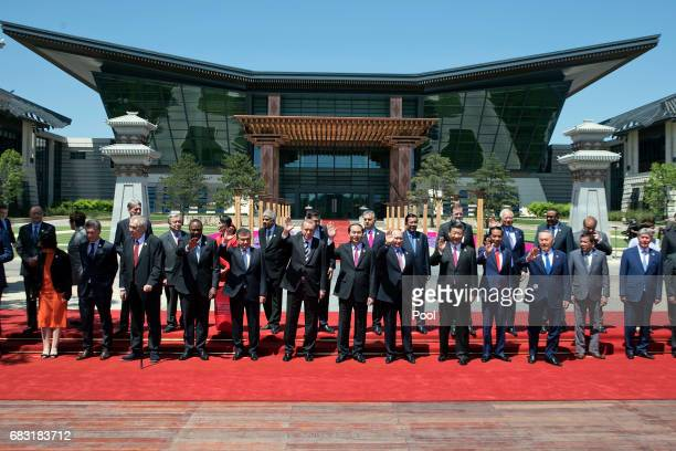 Delegation heads attend the Belt and Road Forum wave as they pose for a group photo at the Yanqi Lake venue on May 15 2017 on the outskirt of Beijing...