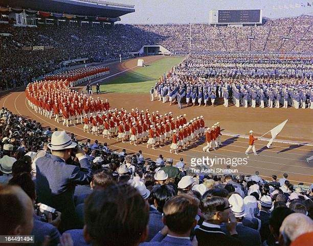 Delegation Japan march during the Tokyo Olympic Opening Ceremony at the National Stadium on October 10, 1964 in Tokyo, Japan.