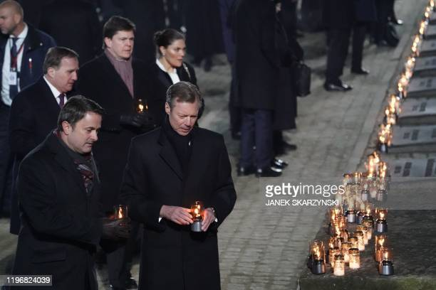 A delegation made up of heads of state and survivors including Prime Minister of Luxembourg Xavier Bettel and Henri of Luxembourg attend a candle...