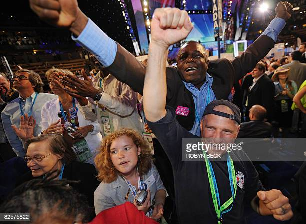 Delegation members celebrate during the Roll Call Vote on the floor of the Democratic National Convention 2008 at the Pepsi Center in Denver Colorado...