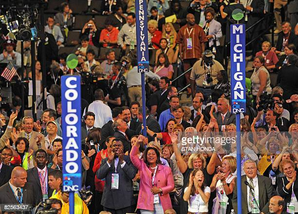 Delegation members crowd the floor of the Democratic National Convention 2008 at the Pepsi Center in Denver on August 26 2008 Hillary Clinton takes...