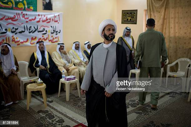A delegation of 19 Sunni sheiks and elders from Fallujah and Anbar Province arrive at the Sadr City central office of the Shia leader Moktada...