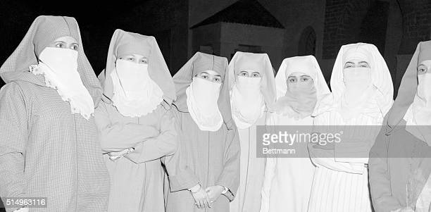 A delegation of women and girls of the Istiqlal Party of Morocco assemble before the Imperial Palace in rabat and perform a symbolic unveiling in...