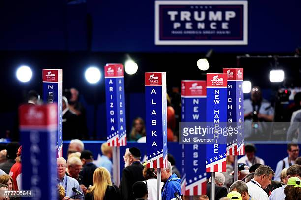 Delegation state signage is seen on the floor prior to the start of the second day of the Republican National Convention on July 19 2016 at the...