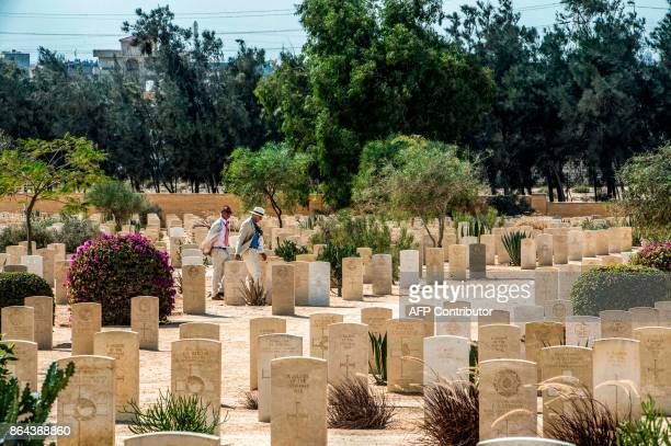 A delegation walks amongst the Allied tombstones at El Alamein War Cemetary during a ceremony marking 75 years since the pivotal WWII battle in the...