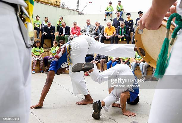 DFB delegation watch a capoeira presentation during a visit of the DFB delegation at Centro Comunitario Casa Mateus on June 09 2014 in Maua Brazil