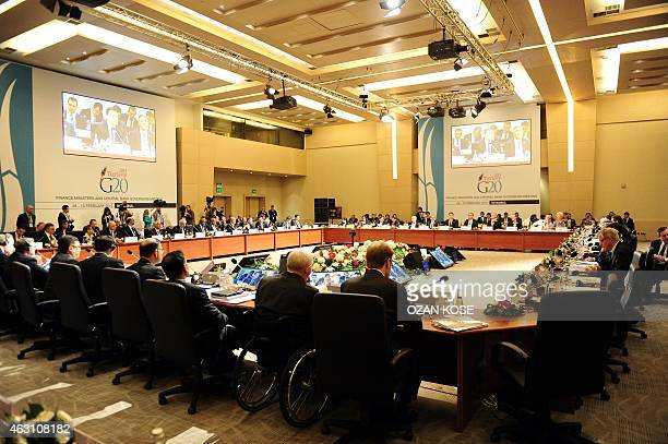 Delegations of finance ministers and bank governors look on as Turkish Deputy Prime Minister Ali Babacan delivers his opening speech during the G20...