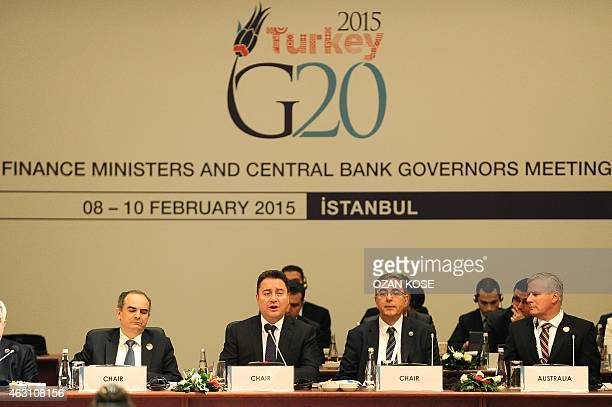 Delegations of finance ministers and bank governors sit along with Turkish Deputy Prime Minister Ali Babacan during the G20 finance ministers and...