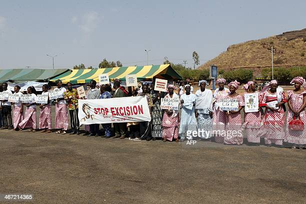 Delegations of women coming from various Malian regions attend a rally against femal genital mutilations on February 6 2014 at the Stade du 26 Mars...