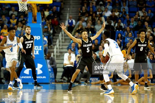 Deleon Brown of the Colorado Buffaloes defends against Aaron Holiday of the UCLA Bruins in the second half during the Colorado v UCLA game at Pauley...