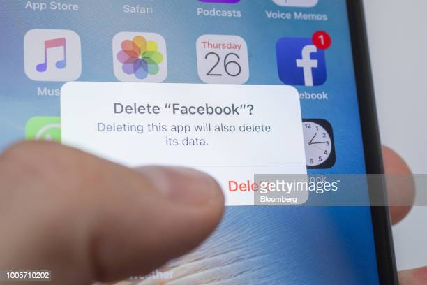 A 'Delete Facebook' message is displayed on an Apple Inc iPhone in an arranged photograph taken in New York US on Thursday July 26 2018 Facebook...