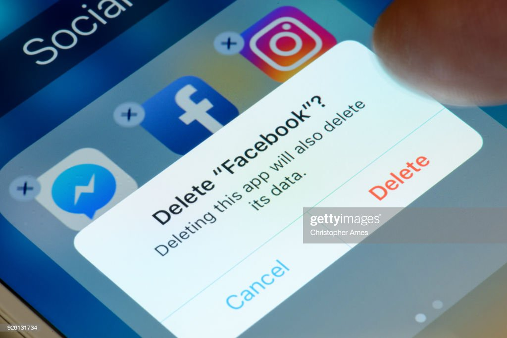 Deleting Facebook App from Smartphone : Stock Photo