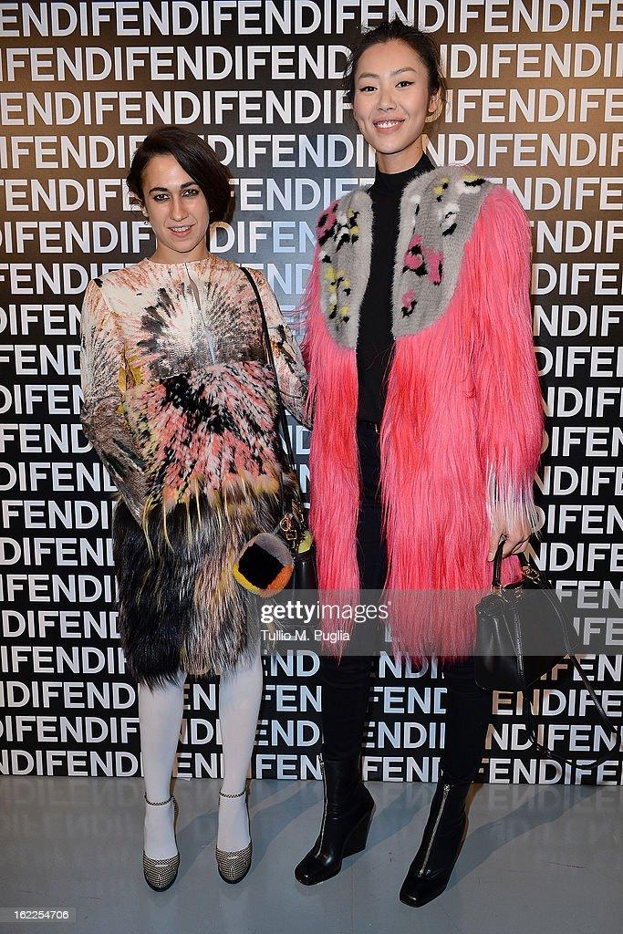 Delfina Delettrez Fendi and Liu Wen attend the Fendi fashion show as part of Milan Fashion Week Womenswear Fall/Winter 2013/14 on February 21, 2013 in Milan, Italy.