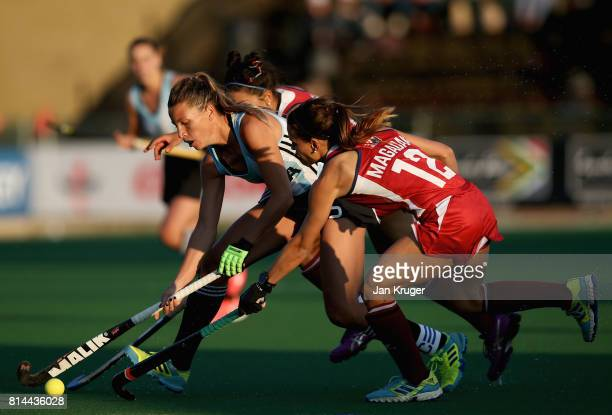 Delfina Merino of Argentina and Amanda Magadan of the United States battle for possession during day 4 of the FIH Hockey World League Semi Finals...