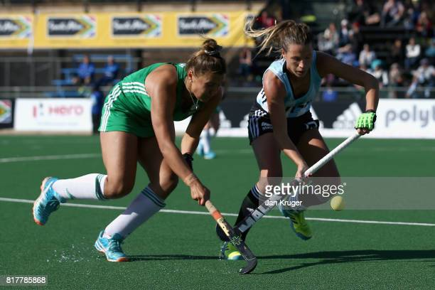 Delfina Merino of Argentina and Elena Tice of Ireland battle for possession during the Quarter Final match between Argentina and Ireland during the...