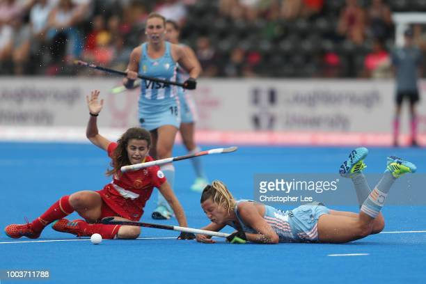Beatriz Perez of Spain and Florencia Habif of Argentina battle for the ball during the Pool C game between Argentina and Spain of the FIH Womens...