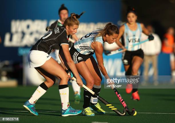 Delfina Merino of Argentina battles with Hanna Granitzki of Germany during day 7 of the FIH Hockey World League Women's Semi Finals semi final match...