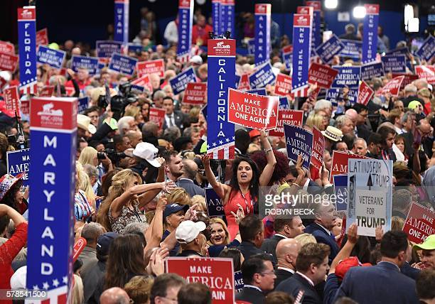 Delgates and signs crowd the floor of the Republican National Convention at Quicken Loans Arena in Cleveland Ohio July 21 2016 / AFP / Robyn BECK