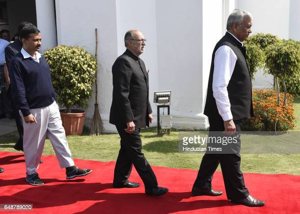 Delhi Assembly speaker Ram Niwas Goel Lieutenant Governor of Delhi Anil Baija Chief Minister of Delhi Arvind Kejriwal procession arrive for the 5th...