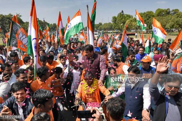Delhi BJP chief Manoj Tiwari seen with Rajlaxmi Manda a biker from Chennai who has undertaken a 56daylong bike expedition seeking a second term for...