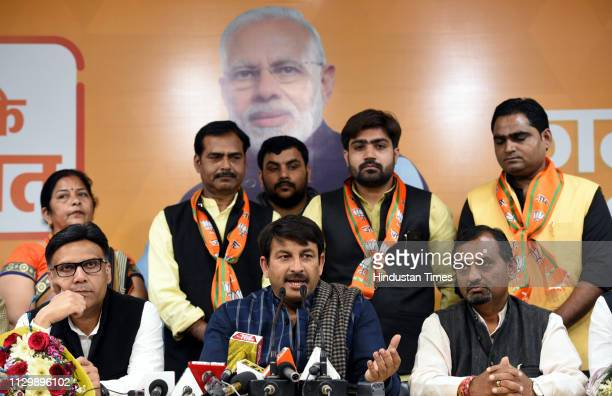 Delhi BJP President and Lok Sabha MP Manoj Tiwari addresses a press conference in the presence of the new BJP members Jitender Chaudhary Aayush...