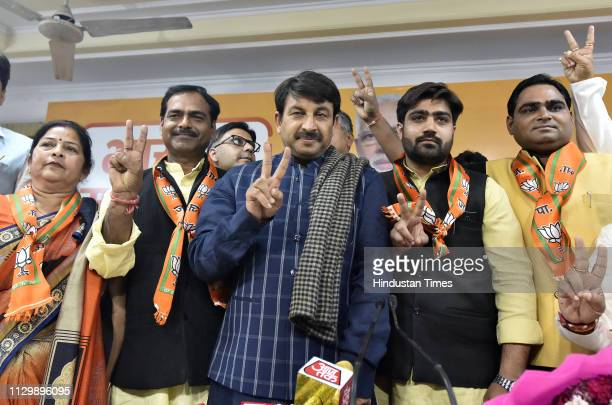 Delhi BJP President and Lok Sabha MP Manoj Tiwari with the new BJP members Jitender Chaudhary Aayush Chaudhary Hemant Jha and Pushpa Sharma at Delhi...