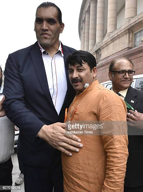 The great khali stock photos and pictures getty images delhi bjp president manoj tiwari with professional wrestler the great khali at the parliament on december voltagebd Image collections