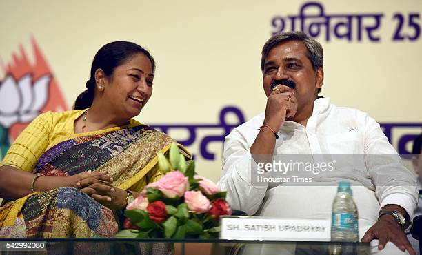 Delhi BJP Secretary Rekha Gupta talking to Delhi BJP President Satish Upadhyay at a function to felicitate the people who were detained under the...
