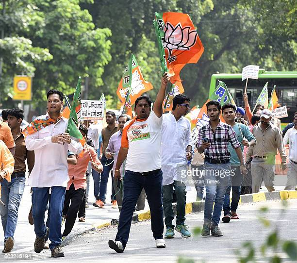 Delhi BJP Yuva Morcha holds a demonstration and shouts slogans against Congress President Sonia Gandhi and Vice President Rahul Gandhi on the issue...