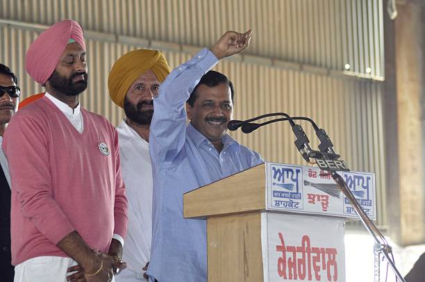 Delhi Chief Minister and AAP National Convener Arvind Kejriwal and AAP assembly candidate from Shahkot Jagtar Singh Sangehra during a rally at new...