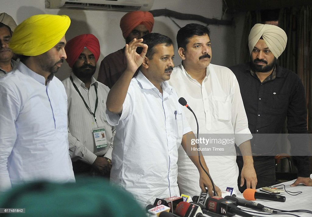 Delhi Chief Minister and AAP National Convener Arvind Kejriwal with AAP MP Bhagwant Mann and AAP Punjab Convener Gurpreet Ghuggi and others during...