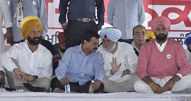 Delhi Chief Minister and AAP National Convener Arvind Kejriwal with Senior AAP leader HS Phoolka and AAP assembly candidate from Shahkot Jagtar Singh.