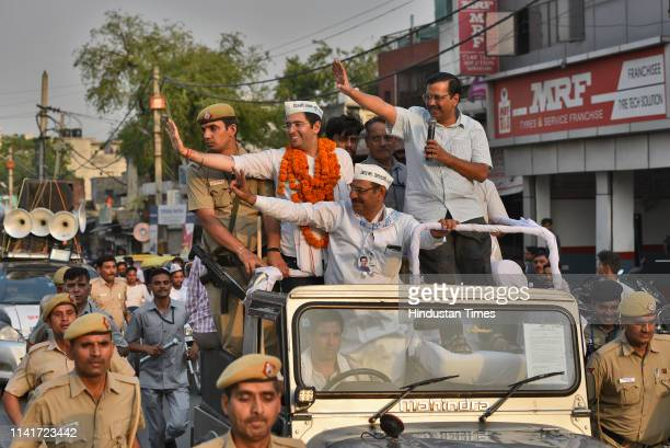 Delhi Chief Minister Arvind Kejriwal AAP candidate from South Delhi Lok Sabha Constituency Raghav Chadha and party supporters during a road show for...