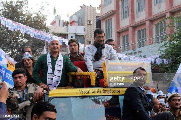 Delhi Chief Minister Arvind Kejriwal along with Deputy Chief Minister Manish Sisodia during a road show campaign for Aam Aadmi Party at Patparganj...