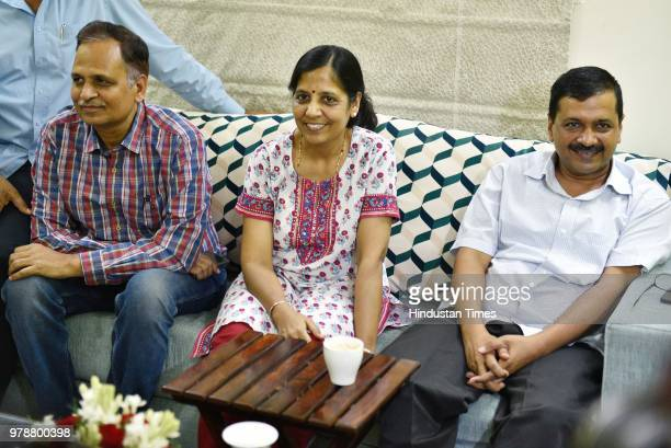 Delhi chief minister Arvind Kejriwal along with his wife Health Minister Satyendra Kumar Jain and Sanjay Singh after coming out of LG's house ending...