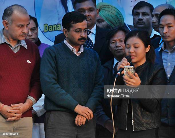 Delhi Chief Minister Arvind Kejriwal and Delhi Education Minister Manish Sisodia join the students from North Eastern states who are sitting on...