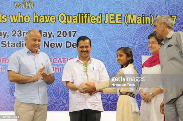 Delhi Chief Minister Arvind Kejriwal and Deputy Chief Minister Manish Sisodia interact with government school students who qualified Joint Entrance...