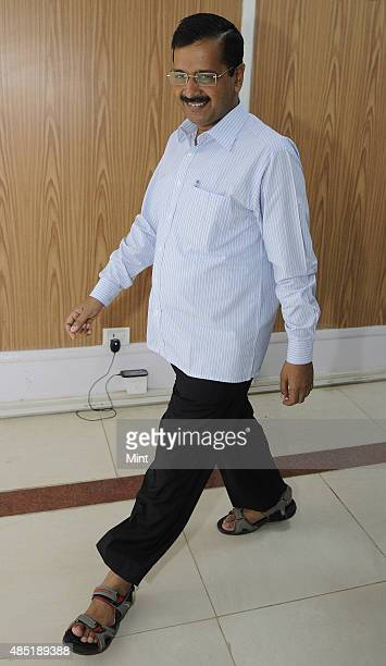 Delhi Chief Minister Arvind Kejriwal arrives for the Registration Ceremony of Airtel Half Marathon at his residence on August 25 2015 in New Delhi...