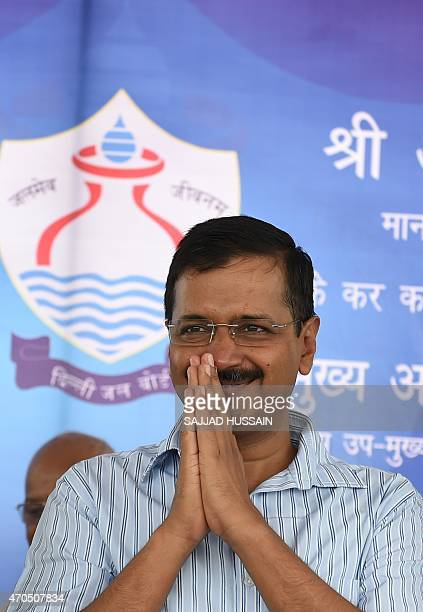 Delhi chief minister Arvind Kejriwal greets after inaugurating the Bawana water treatment plant at Bawana in northern Delhi state on April 21 2015...