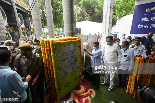 Delhi Chief Minister Arvind Kejriwal inaugurates a 25-metre high smog tower, built to purify the air during pollution season, in New Delhi on August...