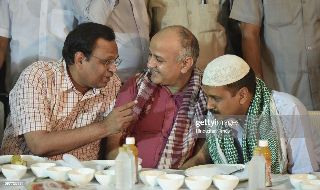 Delhi Chief Minister Arvind Kejriwal listens to Delhi Minister Satyendra Kumar Jain with Delhi Deputy Chief Minister Manish Sisodia during an Iftar at Vidhan Sabha Lawns on June 19, 2017 in New Delhi, India.