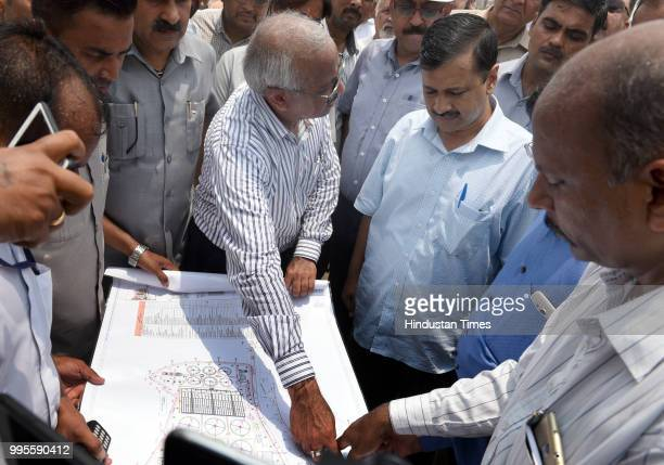 Delhi chief minister Arvind Kejriwal looks at the site map during his visit to Coronation Sewage Treatment Plant at Burari on July 10 2018 in New...