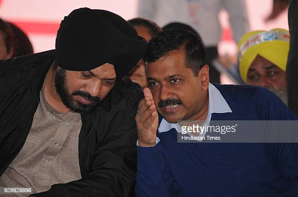 Delhi Chief Minister Arvind Kejriwal sharing with state party convener Gurpreet Singh Ghuggi during a rally on December 10 2016 in Jalandhar India...
