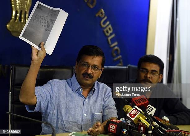 Delhi Chief Minister Arvind Kejriwal showing order dated May 7 through which the then BJP government under Sahib Singh had appointed Nand Kishore...